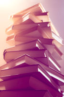 Stack of books in library. Scientific, educational, and fiction paper books. Education and training.