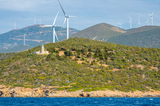 Lighthouse and Wind Farms on a Hilly Shore