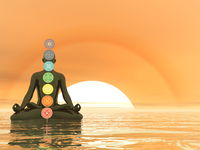 Man meditating upon the ocean and chakra colors - 3D render