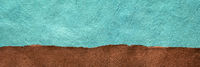 brown field and turquoise blue sky  abstract paper landscape