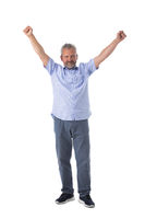 Senior man with arms raised