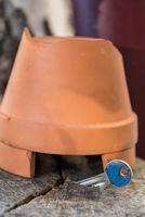 Key hidden under flowerpot - close-up of reserve key