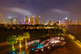 Tracel background of Singapore skyline illumintaed in the evening twilight