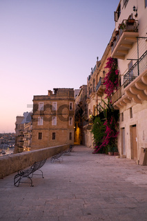 The openwork metal benches on the waterfront of the Senglea, Malta