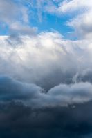 Scenery dramatic thunderstorm clouds with blue sky background