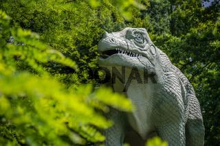 Dinosaur sculpture in a public park
