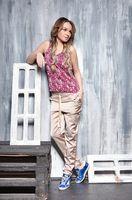 Young beautiful woman posing in studio