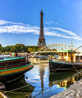 Two river boats near Eiffel tower in Paris, France