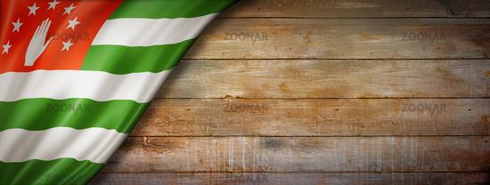 Abkhazian flag on vintage wood wall banner