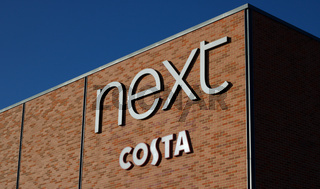 26 September 2020 - UK: Building showing Next and Costa branding with copy space