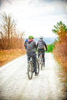 The family makes a bicycle tour through the forest