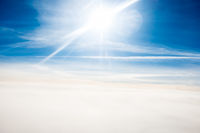Cloudscape view with bright sun