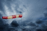 Air sock measuring the wind speed at stormy weather. Hurricane, tornado and storm concept.