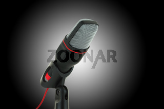 black and red microphone on dark background
