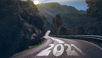 year 2021 and arrow on long winding road