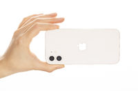 Female hand holding the new iPhone 12 White.