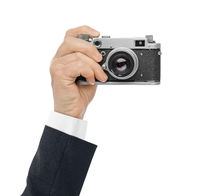 Vintage photo camera in hand