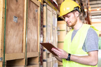 Portrait white caucasian worker with tablet in distribution warehouse