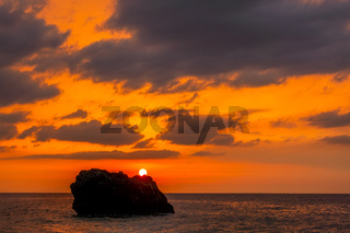 Lonely Rock and Amazing Colors of Sea Sunset