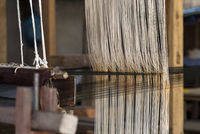 Weaving on a traditional Lao-Thai style loom, Ban Phanom, Laos