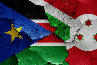 flags of South Sudan and Burundi painted on cracked wall