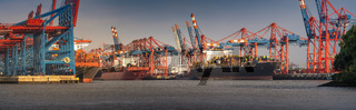 Panorama from a container terminal in the port of Hamburg in sunny weather in the evening