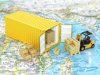Open container with forklift stacker loader holding cardboard boxes on the world map. Transportation concept.