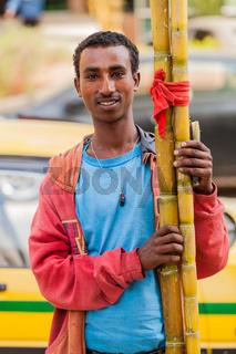 Man selling sugarcane on the street