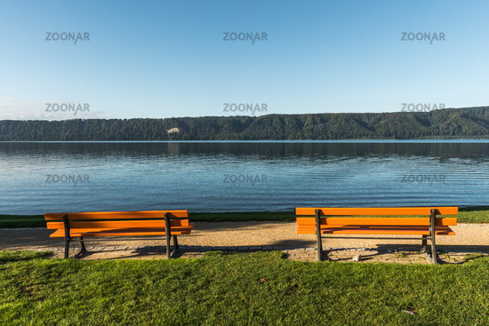 Benches on the shore in Sipplingen with view of Lake Constance, Baden-Wuerttemberg, Germany