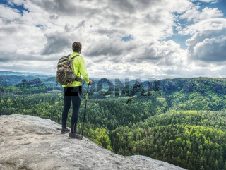 Man trail runner stop on mountain top for relax. Trail athlete