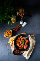 Rustic chicken wings in honey with potato wedges