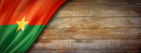 Burkina Faso flag on vintage wood wall banner