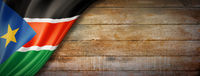 South Sudan flag on vintage wood wall banner