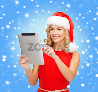 woman in santa helper hat with tablet pc