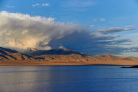 Cloud moving over mountains.