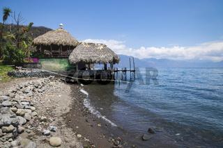 Jetty hut with straw roof at the coast of lake Atitlan at Santa Cruz La Laguna, Guatemala