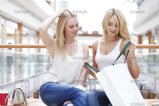 Women looking in shopping bag