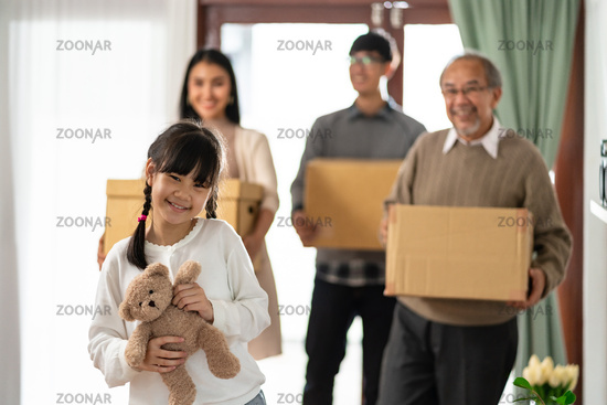 Happy asian multigenerational family moving in new home