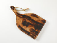 Rustic paddle shaped cutting board