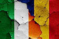 flags of Ireland and Romania painted on cracked wall