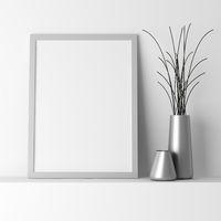blank gray photo frame on white shelf