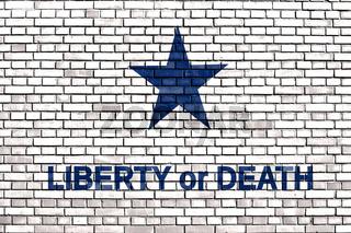 slogan Liberty or Death on a brick wall