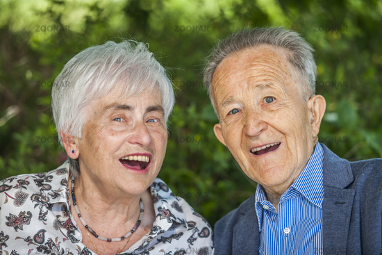 Nice old couple with open laughter