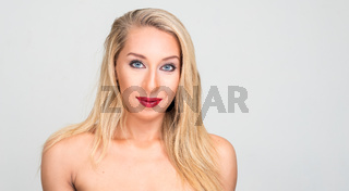 Portrait of young beautiful blonde woman shirtless