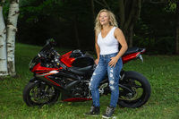 Young woman and motocycle