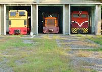 Vintage diesel powered train engines in an old shed