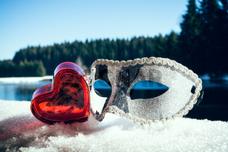 Mask with a heart in the snow landscape