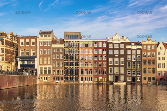 Amsterdam Netherlands, city skyline at canal waterfront and bridge with traditional house in Damrak
