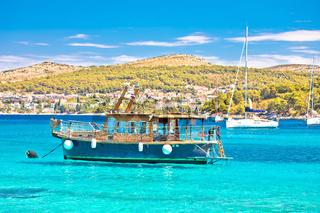 Tourist boat in turquoise sea on Pakleni Otoci islands