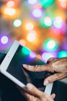 Closeup on elderly woman using a digital tablet